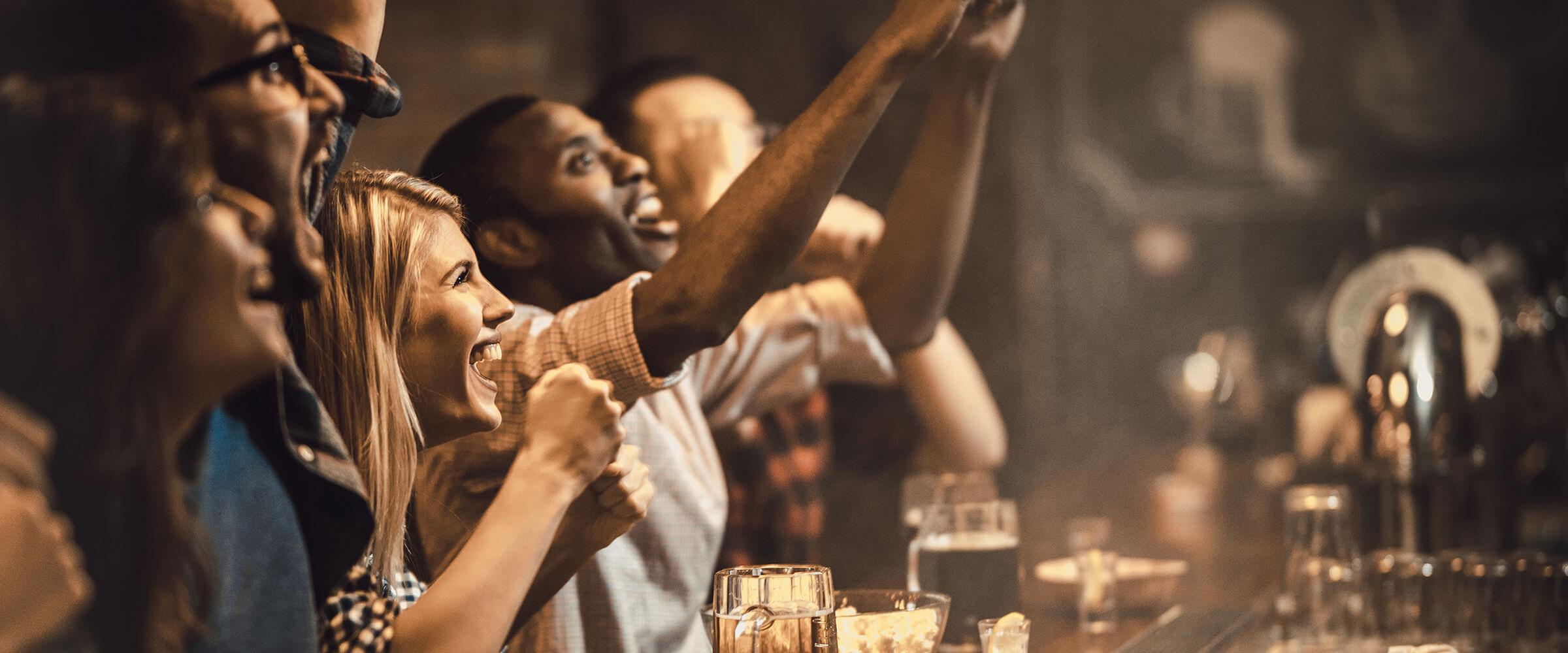 Cheering at a sports bar